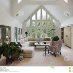 living room with floor to ceiling windows stock image