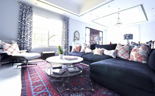 living room with sectional sofa and oriental rug distinctive and