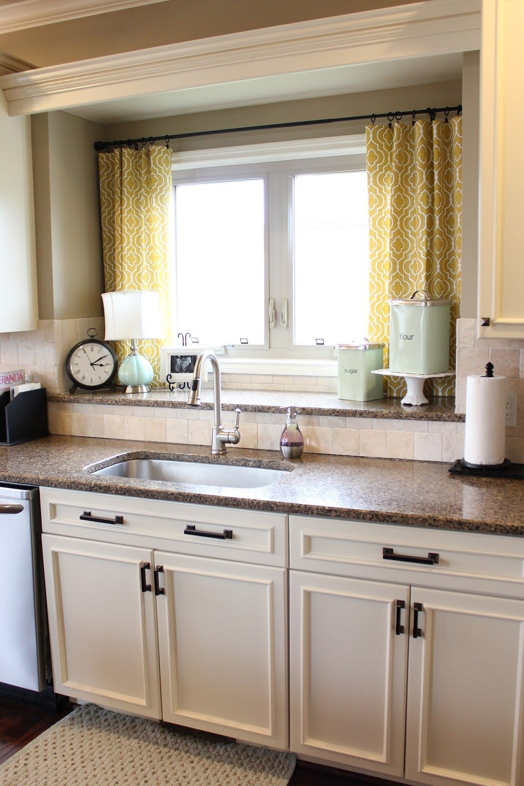 love the double window sill for storagedecor over the sink