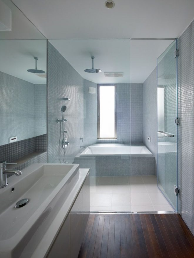 love the mosaic blue tiles and the tub shower combo