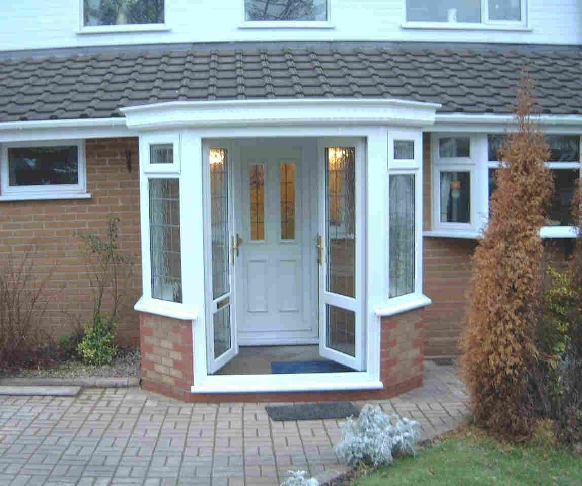 love this small enclosed porch with glass doors prefer a pitched