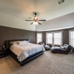 luxurious master suite with high ceilings and sitting area