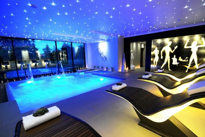 luxury indoor swimming pool with amazing ceiling light decor its