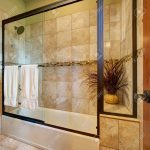 master bathroom interior tub and shower combo features brown