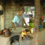 mexican woman in outdoor kitchen in the mountains near puerto