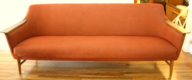 mid century modern couch with wood accented arms