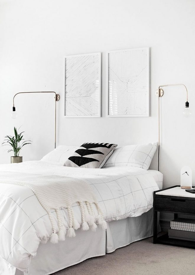 minimalist white bedroom with gold sconces inspiring interiors in