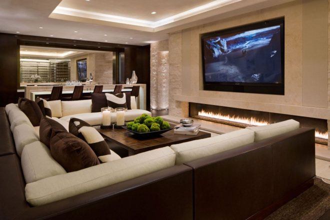 modern and luxury tv room with white and brown furniture