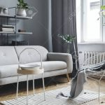 modern and scandinavian living room with design sofa coffee