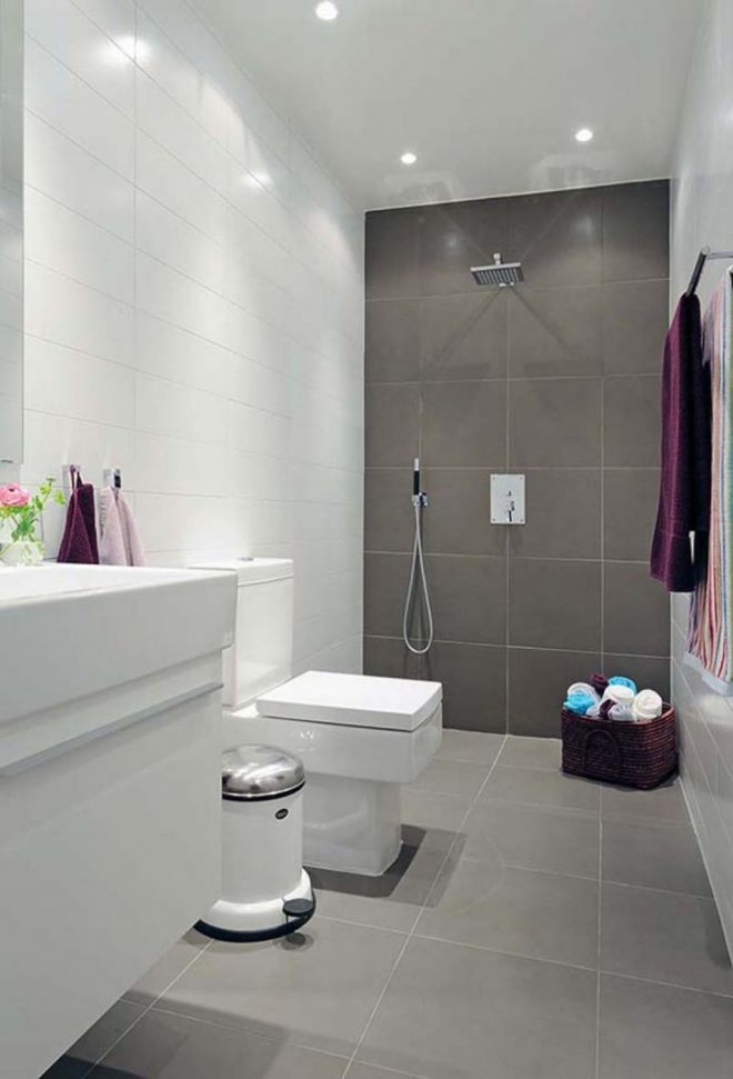 modern bathroom with same tile on floor and wall main wall tiled to