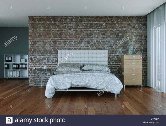 modern bedroom with stone wall and modern decor stock photo