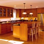 modern cherry wood maple cabinets with glass panel doors
