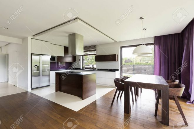 modern design open kitchen with wooden kitchen island and wooden
