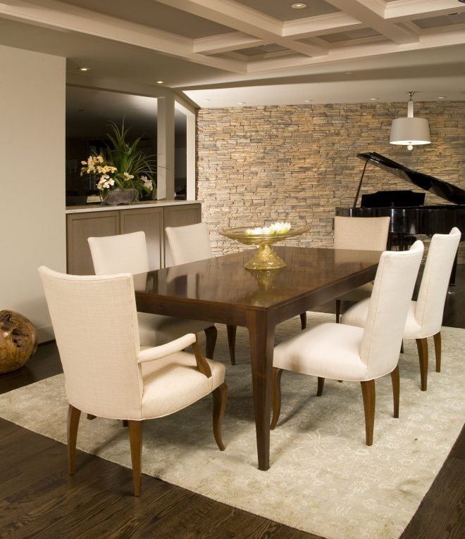 modern dining room with clean lines and neutral stone wall dine