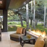 modern fireplace in luxurious backyard patio ideas with cozy