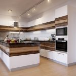 modern kitchen design for apartments with track ceiling lighting and