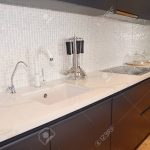 modern kitchen metal faucet cooker hood and ceramic kitchen sink