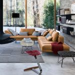 modern leather sofa in tobacco color concrete floor rough