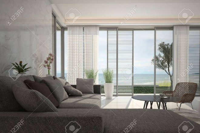 modern living room with floor to ceiling windows