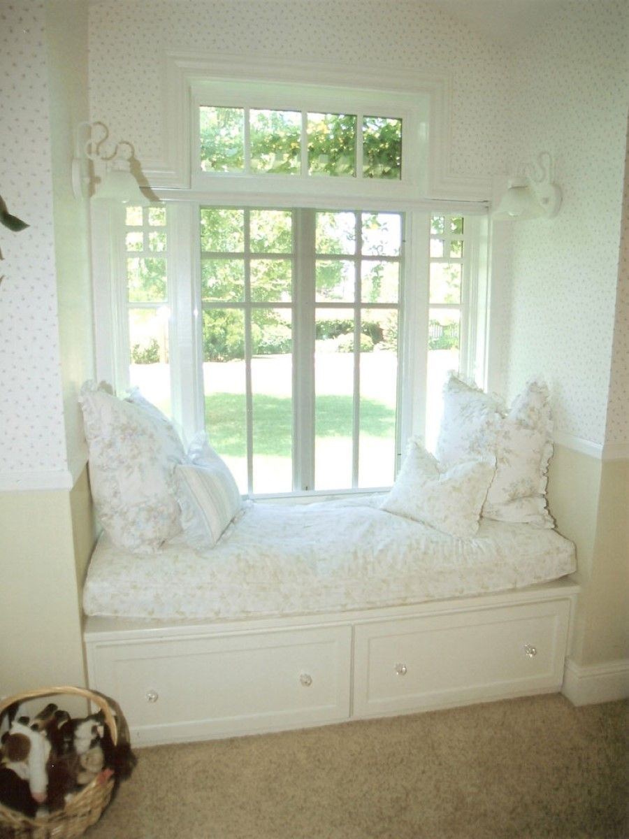 monochromatic white room with bay window window seat french