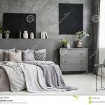 moon canvas on a grey wall in a monochromatic cozy bedroom
