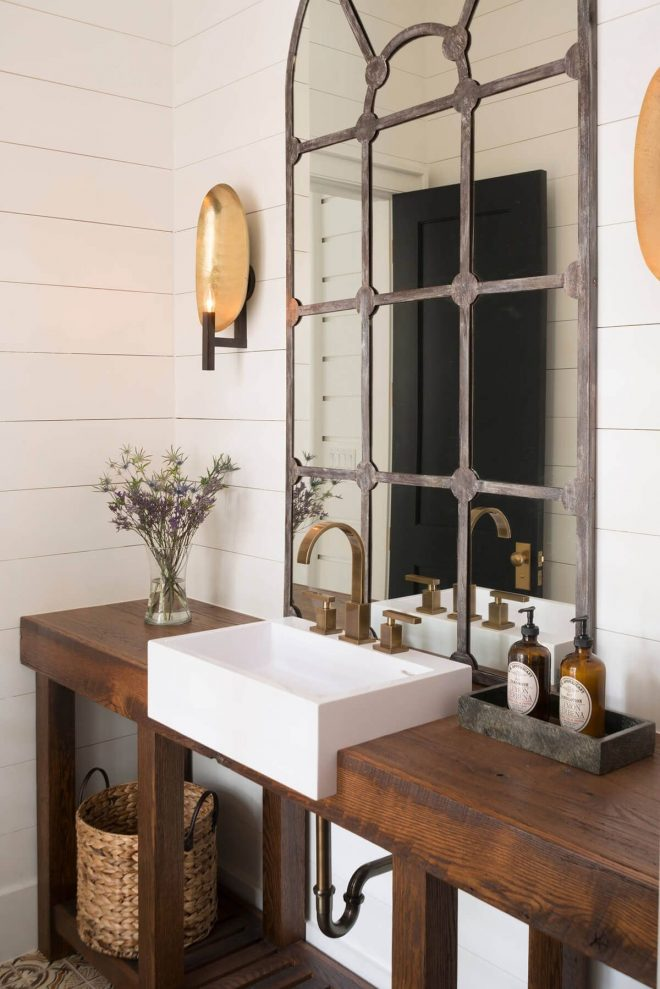 mullioned window mirror over a farmhouse sink modern