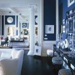 navy walls and dark floors set off white trim and columns