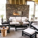 new black and white outdoor patio furniture with stone fireplace