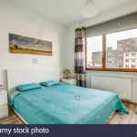 new furnished apartment a bedroom with large windows and a