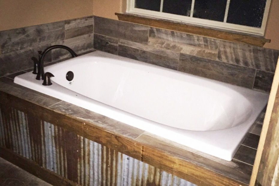 our rustic bath tub metal tin in front with barn wood