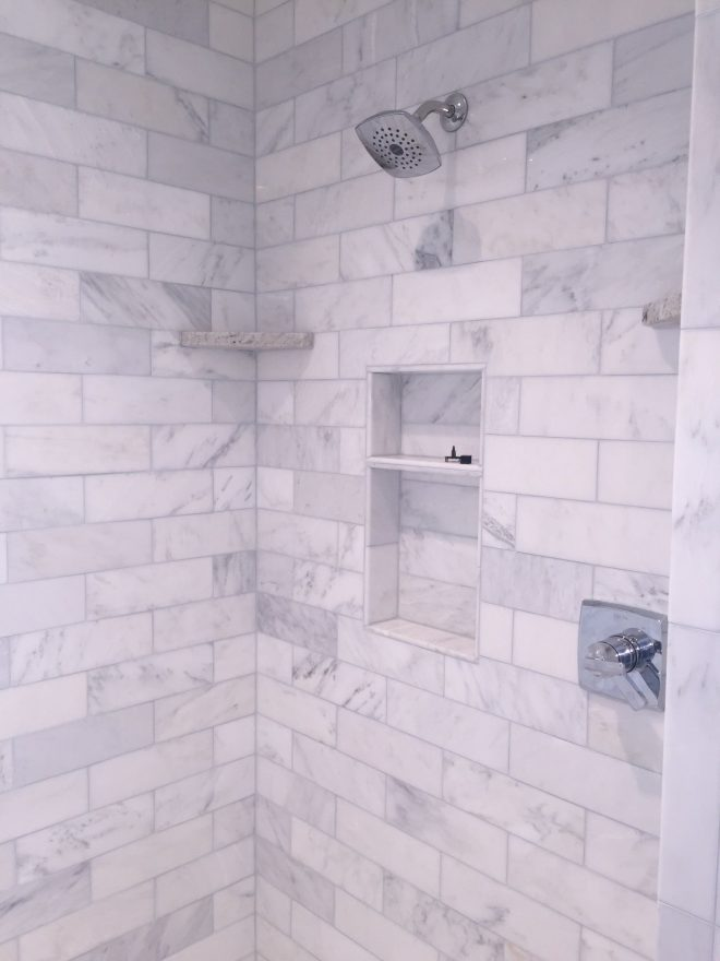our shower in the master bathlove it 4x12 marble subway