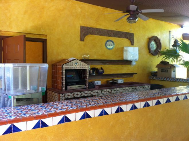 outdoor bar at joe t garcias cement block covered in stucco and