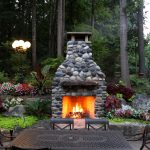 outdoor fireplace made with montana river rock outdoor