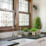 outstanding leaded glass windows above kitchen sink window