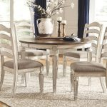oval shaped dining table realyn series ashley furniture