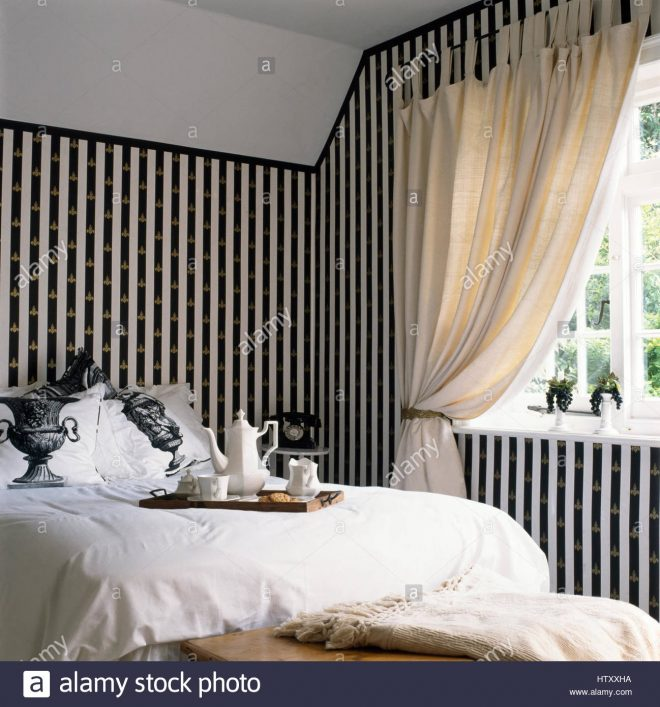 painted blackwhite stripes on wall with a gold stenciled