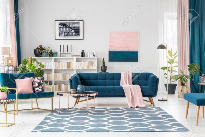 patterned carpet in pink and blue living room interior with sofa