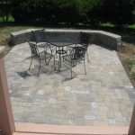 paver patio off deck with sitting wall step down patio off