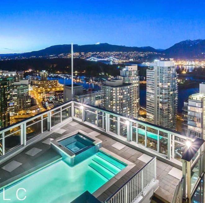 penthouse rooftop pool with a beautiful view homes and