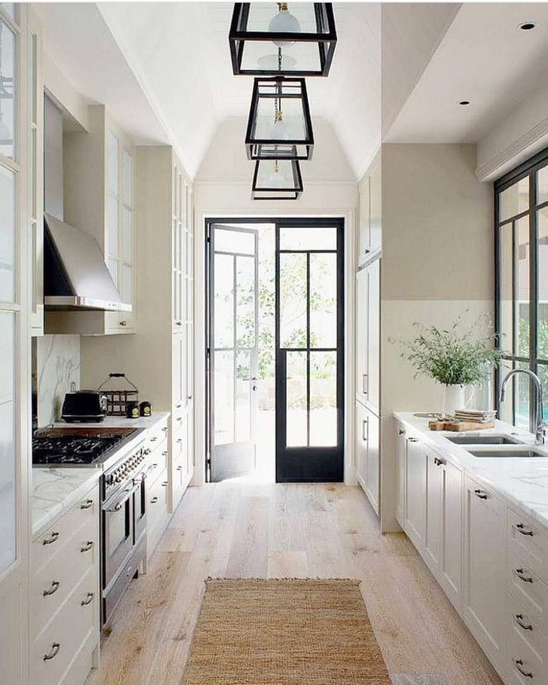 perfect galley kitchen light floors counters and cabinets with