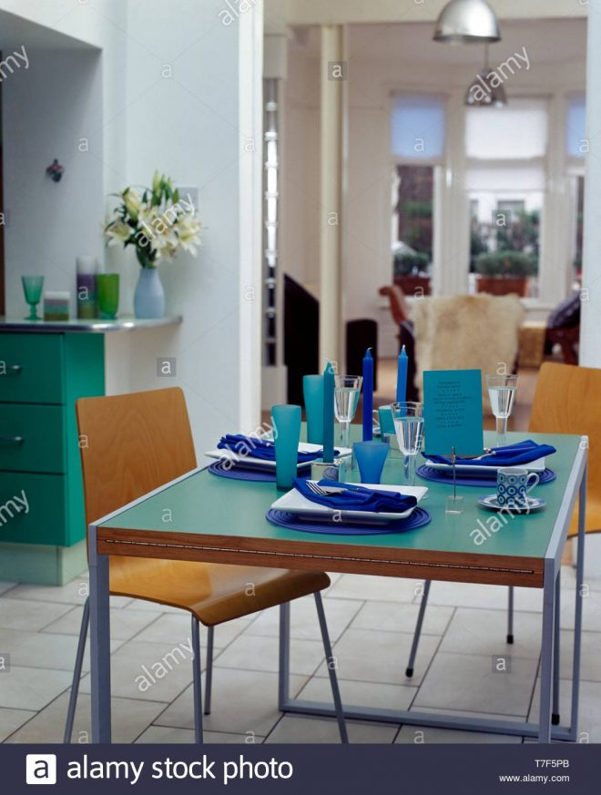 plywood chairs and turquoise topped table in modern dining
