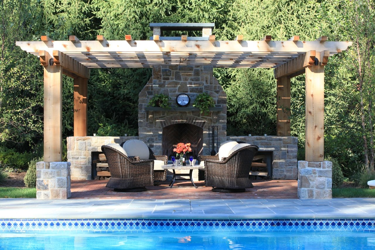 pool pergola patio and a fireplace outdoor fireplaces backyard