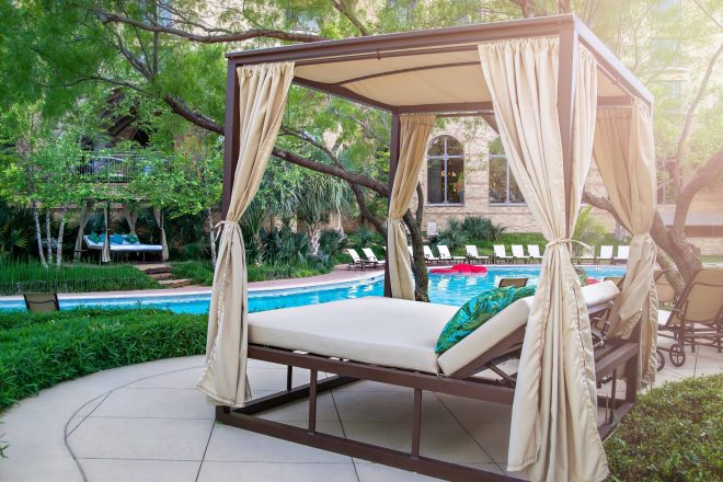 poolside day beds at agave pool bar at four seasons dallas
