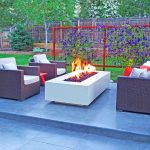 powder coated steel fire pit in modern outdoor living space