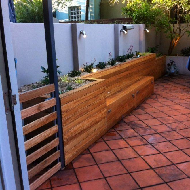 raised garden bed bench seat and storage area cladded with