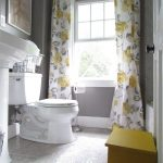 really cute gray and yellow bathroom with vintage style floral