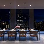 rendering showing views of manhattan night from a dining