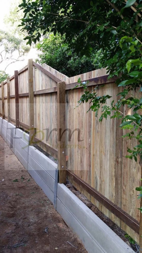 retaining wall with privacy concrete sleepers and timber