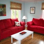 rooms with blue walls red couch beachy living room red