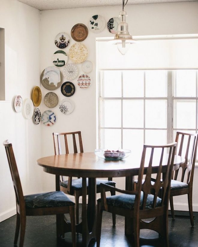 round table with plates as decor plates on wall dining